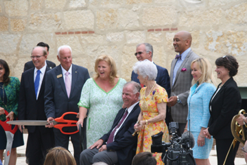 The Mays family with local dignitaries get ready to cut the ribbon in celebration of the new expansion at the Witte Museum.