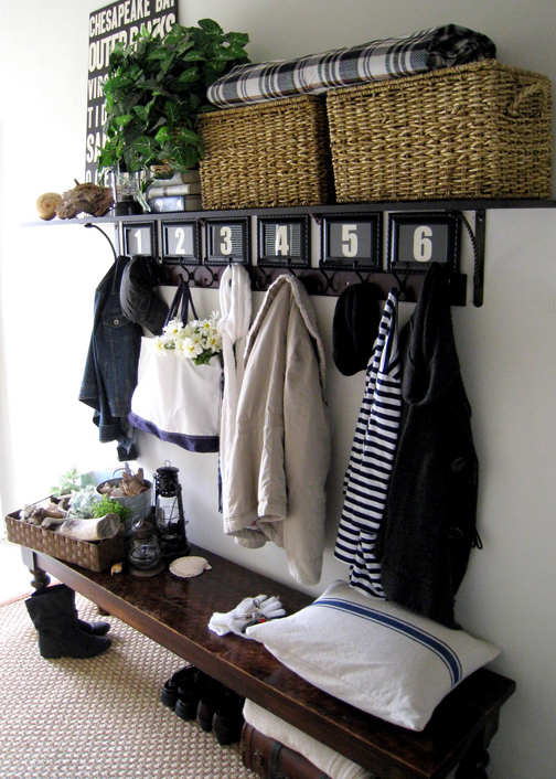 Stylish shelves, hooks, a bench and pretty baskets can be used to control entryway clutter.
