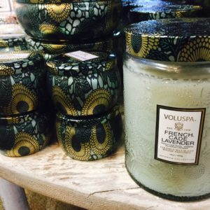 Close-up of candles in shiny, fancy jars from Sunset Ridge.