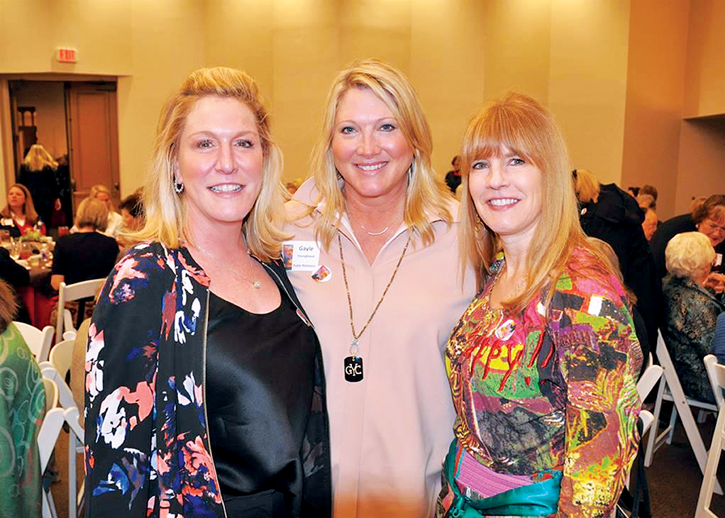 Battle of Flowers members Jill Rosenthal Gayle Youngblood and Mary Beth Mosbacker