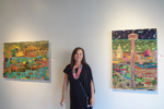 Artist Brook Rosser with two of her paintings Tower of America and Japanese Tea Garden
