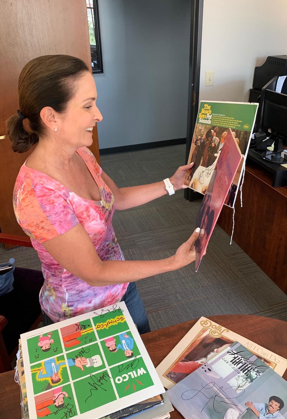Dr Alice Viroslav looks over signed vinyls
