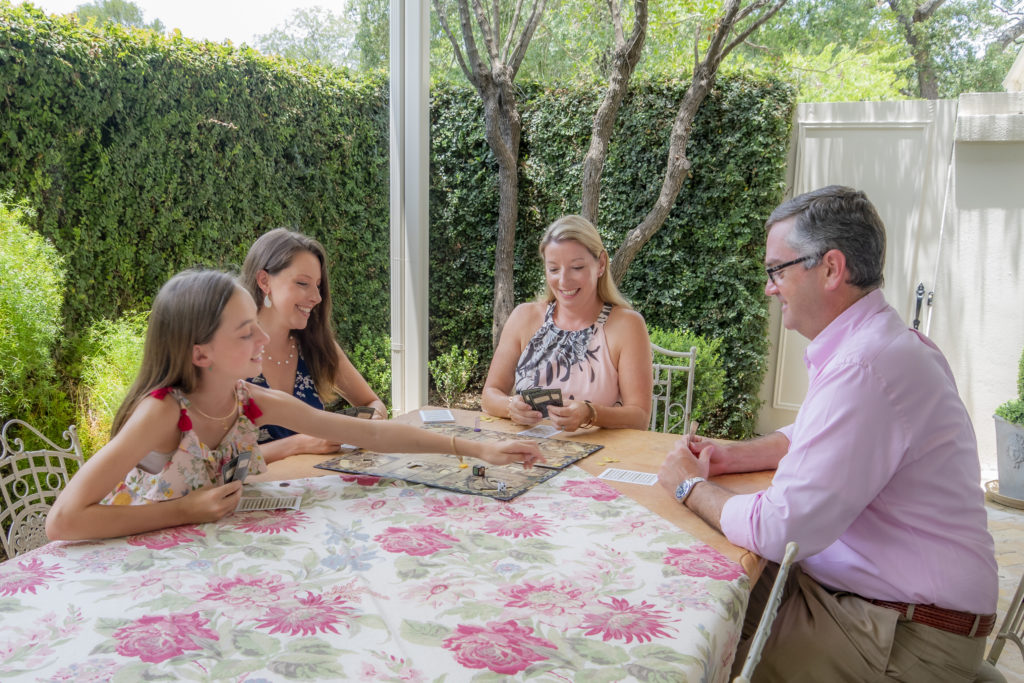 Marvin family playing board games at their patio table