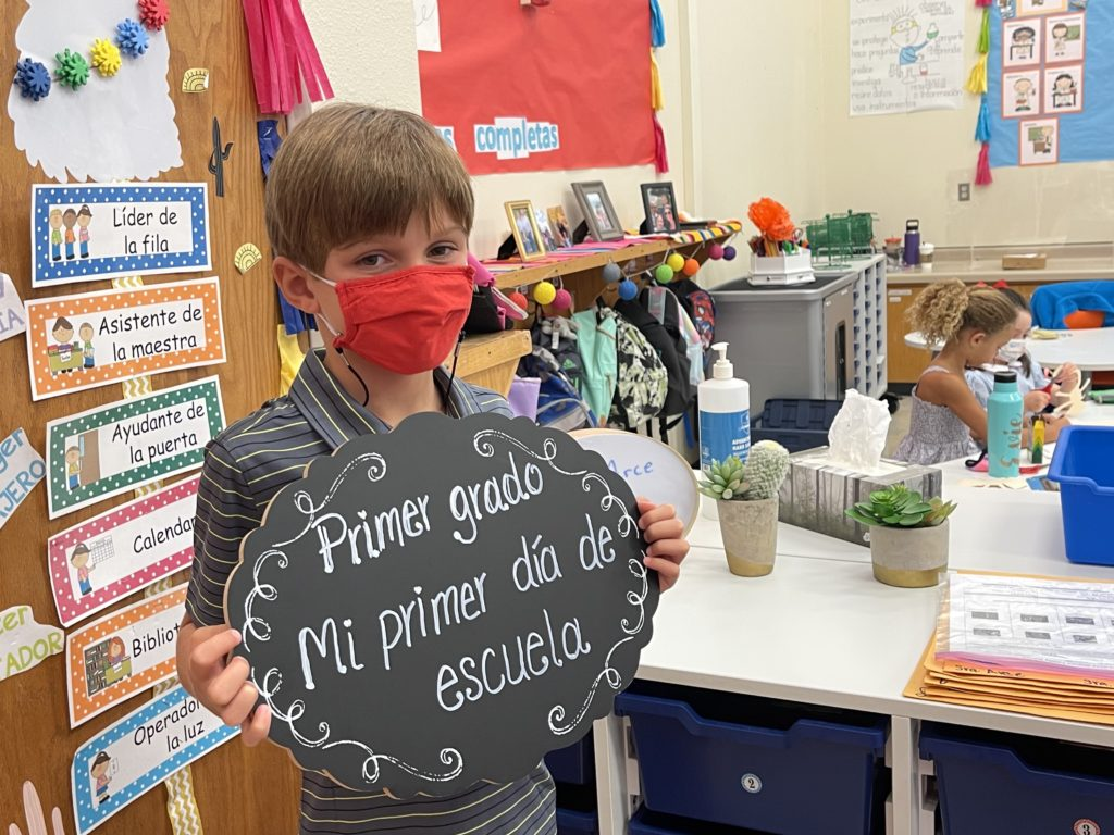 WE 1st Grade language programs kid with sign 1